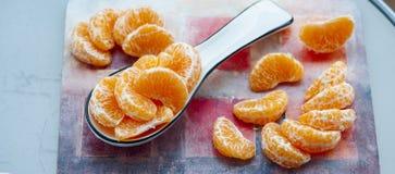 Scheiben von saftigen Mandarinen Stockbilder
