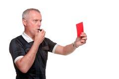 Scheidsrechter die de rode kaart zijprofiel toont Stock Foto's