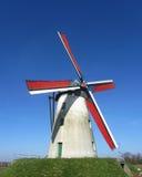 Schelderomolen, Merelbeke, Belgium. MERELBEKE, BELGIUM, MARCH 9 2014:The fully restored and operational windmill 'Schelderomolen'. The historic windmill produces Stock Photography
