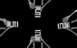 Scheletri che mandano un sms nel gruppo Fotografia Stock Libera da Diritti