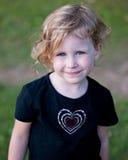 Schelmisches kleines Mädchen Stockfotos