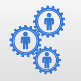 Schematic silhouettes of people inside gears. Stock Images