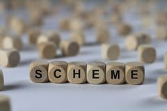 Scheme - cube with letters, sign with wooden cubes Stock Photography