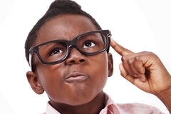 Scheming kid. Young boy face expression making a plan or scheme stock photo
