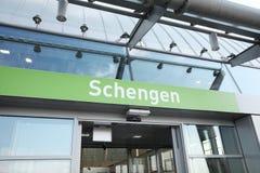 Schengen handstil på flygplatsankomster royaltyfria bilder