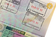 Schengen visa with arrival and departure entry stamp on Thai pas. MUNICH, GERMANY - OCTOBER 2016 : Schengen visa with arrival and departure entry stamp on Thai Royalty Free Stock Images