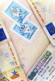 Schengen visa of Greece on the page of the passport and the euro Stock Photo