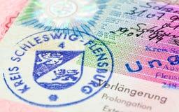 Schengen visa i pass arkivfoto