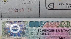 Schengen visa macro in passport Stock Photos