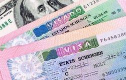 Schengen visa in passport and american dollar bankno. Fragment of Schengen visa in passport and american dollar banknote stock photos