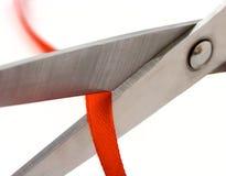 Scheren und rote Zeile Stockbild