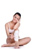 Scherende benen, smiley in het scheren van schuim Stock Foto's