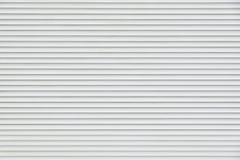 Schermi girevoli orizzontali bianchi del metallo Fotografia Stock