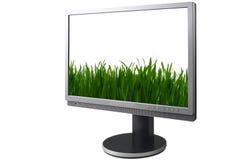 Schermo dell'affissione a cristalli liquidi con il campo verde Fotografie Stock