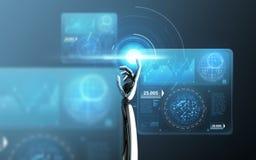 Schermo virtuale commovente della mano del robot sopra il blu Fotografia Stock Libera da Diritti