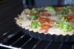 Scherp in de oven stock fotografie