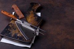 Scherp raad en mes met vork voor vlees Stock Foto