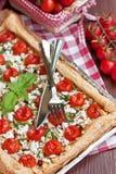 Scherpe de tomaten van de kers Stock Afbeeldingen