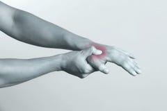 Scherpe pijn in een mensenhand Stock Afbeeldingen