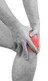 Scherpe pijn in een mensenknie. Mannelijke holdingshand aan vlek van knie-ACH Royalty-vrije Stock Foto's