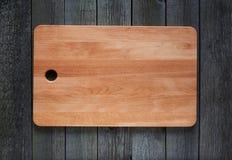 Scherpe raad met ruimte voor tekst op oude houten achtergrond Royalty-vrije Stock Foto