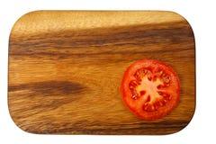 Scherpe raad met tomatenplak Royalty-vrije Stock Foto