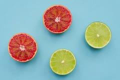 Scherpe rijpe kalk en rode sinaasappelen - gezond levensstijlconcept Royalty-vrije Stock Afbeelding
