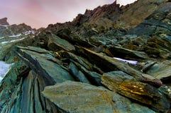 Scherpe rotsen dichtbij piek Grossglokner.   Stock Afbeelding
