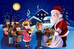 Scherza la donazione durante il Natale Immagine Stock Libera da Diritti