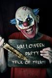 Scherzetto o dolcetto diabolico del partito di Halloween del testo e del pagliaccio Immagine Stock