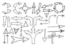 Schetsmatige pijlen op witte achtergrond stock illustratie