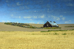 Scheune auf den Weizengebieten auf Landstraße 2 nahe Waterville, WA Lizenzfreies Stockfoto