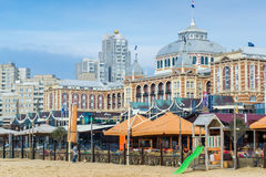 Scheveningen. Beach, the hague, the netherlands, famous hotel on the background and bar and pubs on the foreground Stock Photos
