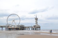 Scheveningen beach. One of the eight districts of The Hague, Netherlands. Modern seaside resort with a long, sandy beach, an esplanade, a pier, and a stock photo