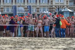 Impatient to dip in the freezing cold water. SCHEVENINGEN, 1 January 2018 - Impatient Dutch people follow the strong tradition of the first new year dive royalty free stock photo