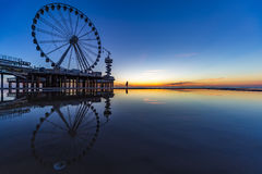 Scheveningen sunset silhouette. Sunset at the Ferris wheel and the Pier structure above the North sea, Scheveningen, Netherlands Stock Images