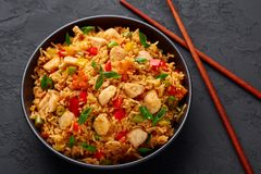 Free Schezwan Chicken Fried Rice In Black Bowl At Dark Slate Background. Indo-chinese Cuisine Dish Royalty Free Stock Photos - 159831808