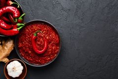 Free Schezwan Sauce In Black Bowl At Dark Background. Schezwan Sauce Is Indo-chinese Or Sichuan Cuisine Hot Sauce With Red Chilli, Royalty Free Stock Image - 159221386