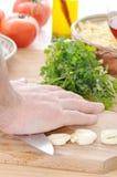 Schiacciamento dell'aglio Fotografia Stock