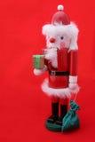 Schiaccianoci della Santa su colore rosso Fotografia Stock