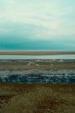 Schichten Sie felsigen Strand von Nordmeer, Holkham-Strand, Vereinigtes Königreich Stockfoto