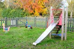 Schieben Sie in einen Kindertagesstättenspielplatz Stockfoto