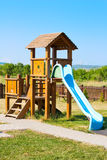 Schieben Sie für die Kinder auf dem Spielplatz Stockbilder