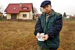 Schiebendes polnisches Bargeld des Landwirts Lizenzfreies Stockfoto