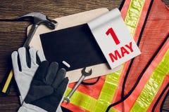 Schieferbrett, Schutzkleidung und Handwerkzeug Lizenzfreies Stockfoto