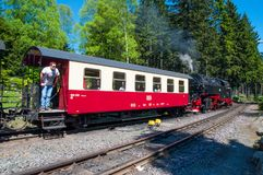 Steam train leaving Schierke train station in Germany. Schierke Germany - May 27. 2017: Steam train leaving Schierke train station in Germany Royalty Free Stock Photo