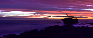 Schiffbruch bei Kap Agulhas, Südafrika bei Sonnenuntergang stockfotografie