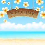 Schild willkommene anf Blumen auf tropischem Strand Lizenzfreie Stockfotografie