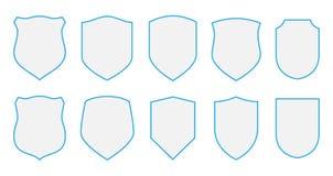 Schilden geplaatst defensiemalplaatjes Grafische het ontwerpelementen van de middeldecoratie Stock Fotografie