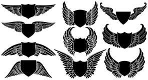 Schilden met Vleugels Royalty-vrije Stock Afbeeldingen